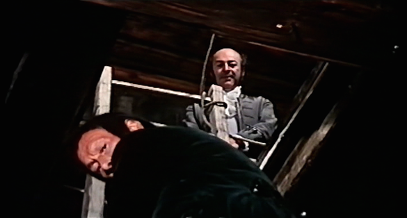 Elisabeth's interrogation through a hatch in the floor in Mark of the Devil Part II